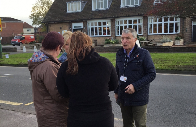 Cllr Brian Holmes talking to local residents about the plans for the phone mast